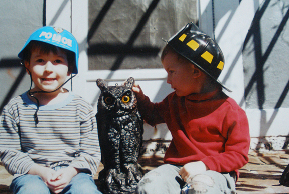 Police and Fire Hats with Plastic Owl: Liam and Evan McKinnon