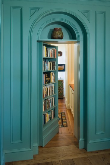 house on penobscot bay library bookshelf secret door doorway blue, photo by Peter Pennoyer Architects